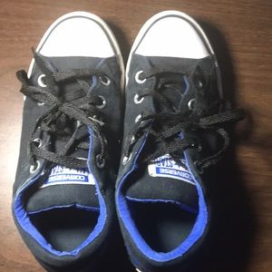 Black ,white, and blue converse